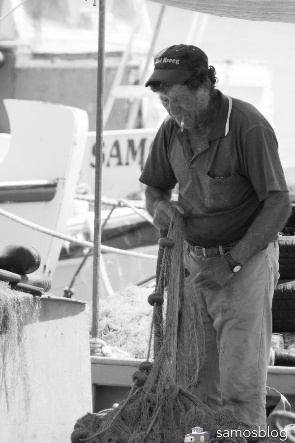 Fisherman in the small habour in Ireon